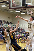 New London's Ben Dentlinger (20) blocks a shot by Notre Dame's Jett Tjaden (11)
