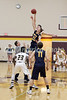 New London's Ben Dentlinger (20) wins the tipoff over Notre Dame's Jack Giannettino (32)