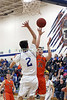 Van Buren's Greg Wenke (34) lofts a floater over Danville's Kole Perkins (2) Tuesday, February 7, 2017 at Danville.<br /> Photo by Donald K. Aliprandi