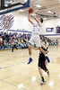 Danville's Kole Perkins (2) shows his vertical leap on a layup past Winfield-Mt. Union's Mitchell Niebuhr (13) Thursday, February 16, 2017 in the Class 1A, District 10 quarterfinal at Danville.<br /> Photo by Donald K. Aliprandi