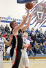 Winfield-Mt. Union's Jordan Hudson (42) shoots from almost under the backboard against Danville Thursday, February 16, 2017 in the Class 1A, District 10 quarterfinal at Danville.<br /> Photo by Donald K. Aliprandi