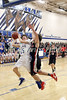 Danville's Tristan Miller (15) tries for a basket defended by Winfield-Mt. Union's Broc Mullin (14) Thursday, February 16, 2017 in the Class 1A, District 10 quarterfinal at Danville.<br /> Photo by Donald K. Aliprandi