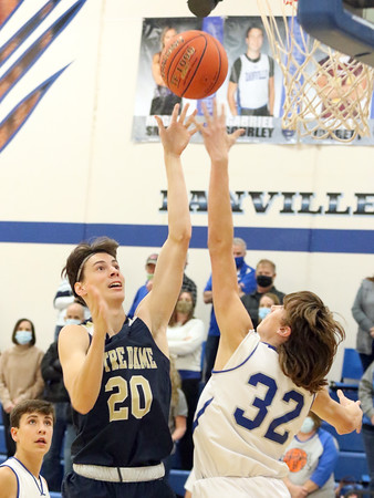 Notre Dame's Josh Smith (20) and Danville's Sawyer Nelson (32)