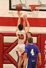 Danville's Mason Speer (#4), Connor Hoelzen (#42) and Cardinal's Brandon Potts (#30)