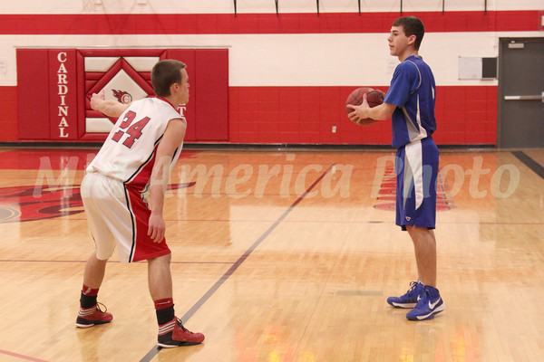 Danville's Connor Hogberg (#2) and Cardinal's Cody Carter (#24)