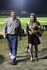 "Homecoming Queen Claire Coleman is escorted back to her ""chariot"" by her dad, Doug Coleman after her coronation during half-time.<br /> Photo by Donald K. Aliprandi"
