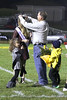 Doug Coleman places the Homecoming Queen tiara on his daughter Claire Coleman during half-time.  He is assisted by Princess Rili McPherson and Prince Eli Hinton who is holding the queen's flowers.<br /> Photo by Donald K. Aliprandi