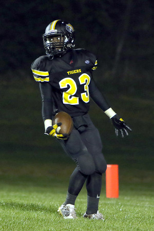 New London's Keontae Luckett (23) looking back for any defenders after scoring a touchdown.