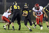 New London's Britt Noel (27, center) looks for a safe route downfield after Cory Jacobs (53) blocked Cardinal's Devon Danger (54) and Cole Helmerson (52) blocked Cardinal's Trenton Durflinger (22).<br /> Photo by Donald K. Aliprandi
