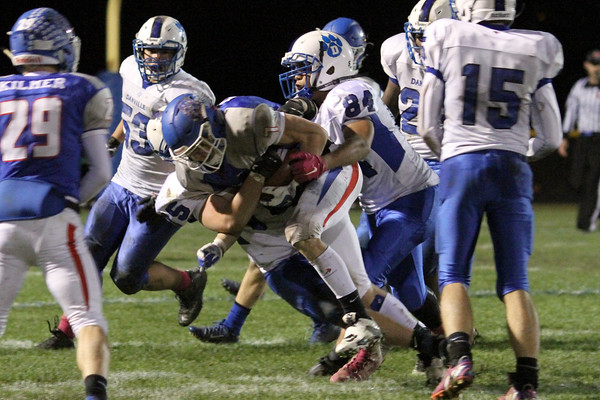 BGM's Jayce Knight (#7) and Danville's Gage Jarrett (#75) and Bryton Rice (#84)