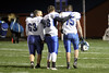Danville's Cody Adler (#63), Bailey Rump (#88), and Gage Jarrett (#75)