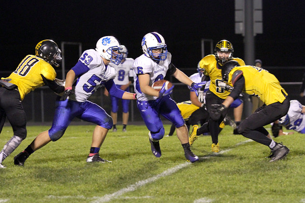Lone Tree's Sam Fuhrmeister (#18) and Danville's Zach Morgan (#53) and Grant Samples (#6)