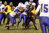 Danville's J.D. Stirn (#52), Bryce Carr (#12) and Lone Tree's Sam Fuhrmeister (#18)