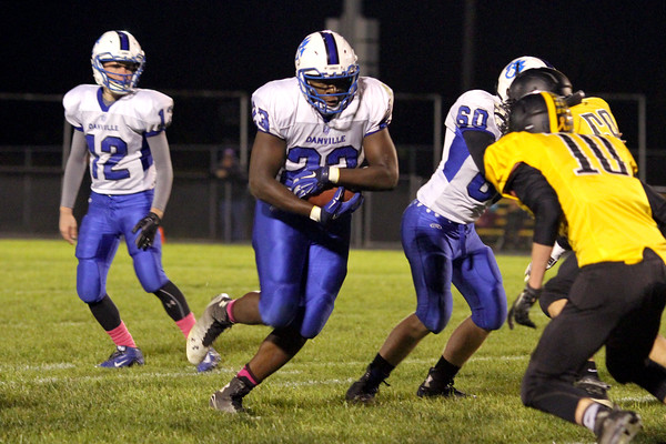 Danville's Bryce Carr (#12), Rayshawn Baylark (#23) and Lone Tree's Brock Smith (#10)