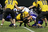 Danville's Jake Jackson (#60), Gage Jarrett (#75) and Lone Tree's Jared Hudson (#30)