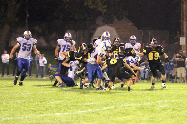 A herd of New London gets swarmed by Danville trying to defend their runner Nick Fencl (#12)