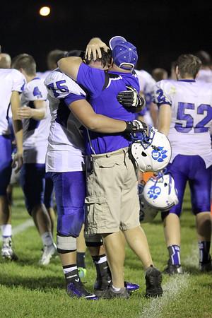 Danville's Gage Jarrett (#75) embracing Head Coach John Stirn