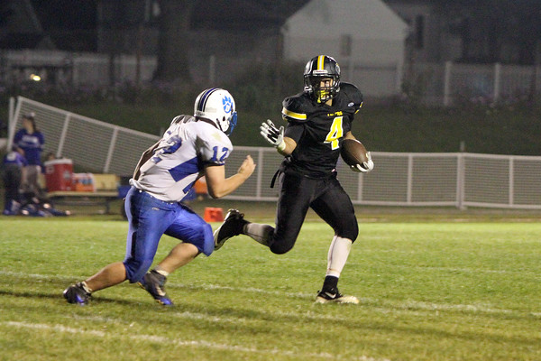 New London's Quincy Porter (#4) and Danville's Nick Fencl (#12)