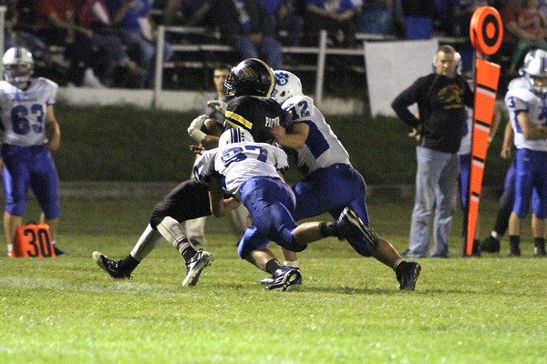 New London's Quincy Porter (#4) and Danville's Austin Heston (#87) and Nick Fencl (#12)