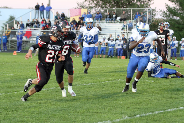 Pekin's Chase Copeland (#21), Trevor Northup (#8) and Danville's Mark Hopson (#32) and Rayshawn Baylark (#23)