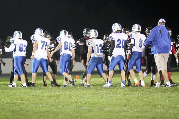Danville's Cody Adler (#63), Ethan Ehrhart (#71), Jonathan Perdelwitz (#80), Nick Fencl (#12), Josh Deggendorf (#20), Mason Lorber (#8) and Assistant Coach
