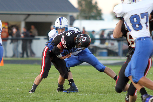 Danville's Nick Fencl (#12) and Pekin's Chase Copeland (#21)