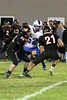 Danville's J.D. Stirn (#52) and Van Buren's Colton Kisling (#65) and Will Mertens (#21)