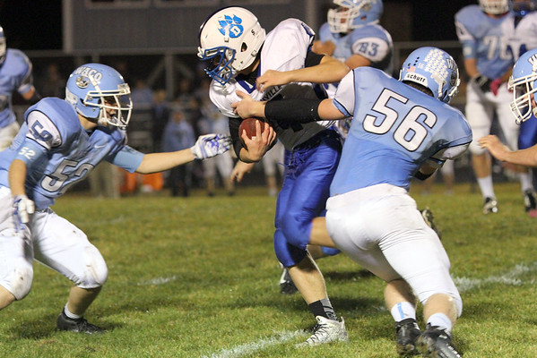 Danville's Sawyer Foster (#4) and WACO's Jason Sammons (#52) and Duncan Pickard (#56)