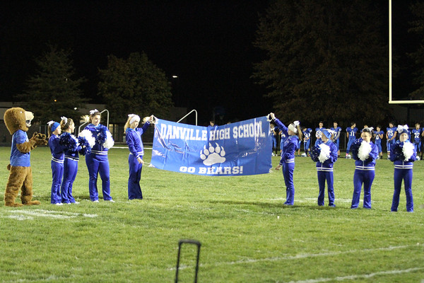 The Danville cheerleaders hold up the banner.