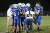 Danville team huddle- Mason Lorber (#8), Kole Perkins (#11), Connor Hoelzen (#18)