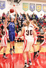 Danville's Gabbie Grothe (#1) and Cardinal's Lexi Fullenkamp (#20), Delaney Ridgway (#30), Dakota Durflinger (#34) and Jessie McElderry (#24)