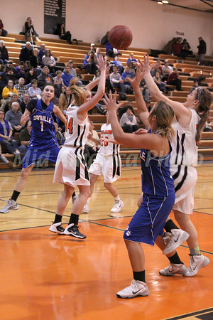 Danville's Gabbie Grothe (#1), Carlee Kelly (#3) and Fairfield's Hanna Greiner (#34) and Mikaela Lunsford (#30)