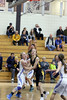New London's Paetyn Prottsman (#12), Ashley Birdsell (#25) and Columbus' Anna Hamilton (#2)