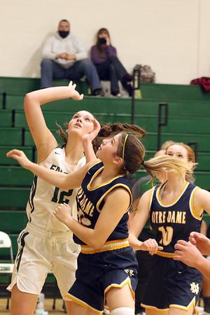 West Burlington's Leah Collier (12) and Notre Dame's Lauren Krieger (15) and Abby Korschgen (10)