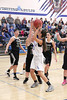Danville's Gabbie Grothe (#0) and West Burlington's Cammy Salvador (#33), Nicole Nichols (#13) and Aubrey Schmitt (#21)