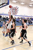 Danville's Kinsey Petersen (#20), Allie Boyer (#22) and West Burlington's Mickenzie Larpenter (#33), Aubrey Schmitt (#21)