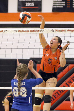 Donald K. Aliprandi/The Hawk Eye<br /> Mediapolis' Kilie Akers (5) spikes the ball over Danville's Teagan Kruse (68) in the Class 2A Region 8 Quarterfinal match at Mediapolis.