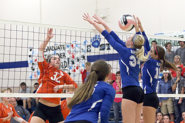 Van Buren's Hannah Hudson (32) spikes the ball between Danville defenders Emmy Jarret (34) and Grace Grothe (15) during the match against Danville October 18th during the class 2A Region 8 Round 1 match at Danville.<br /> Photo by Donald K. Aliprandi