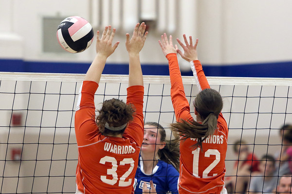 Van Buren's Hannah Hudson (32), Grace Davidson (12), and Danville's Bailey Beckman (27)