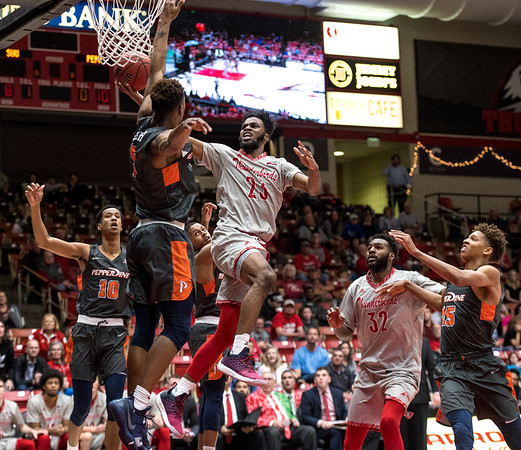 Southern Utah University junior Cameron Oluyitan (23) scores a basket with seconds remaining to force an overtime during the game against Pepperdine University in the America First Event Center Saturday, December 15, 2018. SUU won in overtime, 78-69.