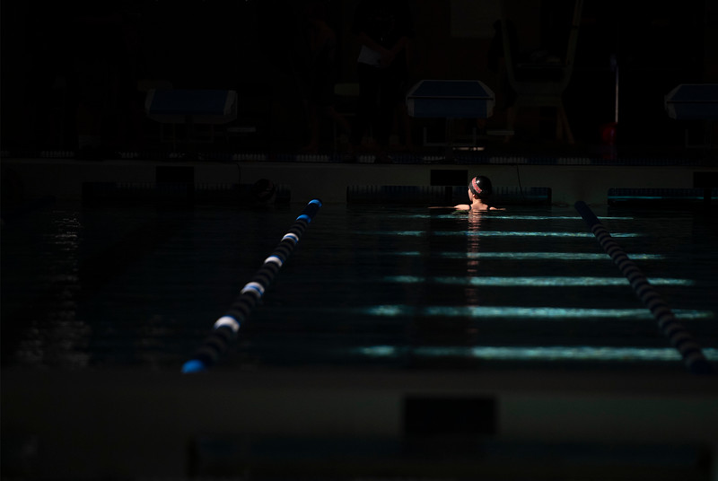 A Loveland swimmer waits to exit the pool during the Front Range League championships at Edora Pool Ice Center in Fort Collins, Colo. on Friday, March 5, 2021.