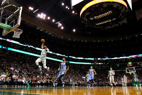 Jaylen Brown #7 of the Boston Celtics dunks the ball during the fourth quarter of a game against the Memphis Grizzlies at TD Garden on February 26, 2018 in Boston, Massachusetts.