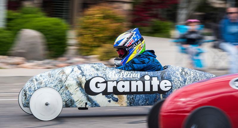 Competitors race downhill in the Rallystop Soap Box Derby at Providence Center Saturday, May 12, 2018. Businesses from across Cedar City sponsored cars for the event.