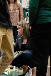 Brockport Women's Basketball Head Coach going over game plans during a timeout against the Potsdam Bears on December 8, 2018