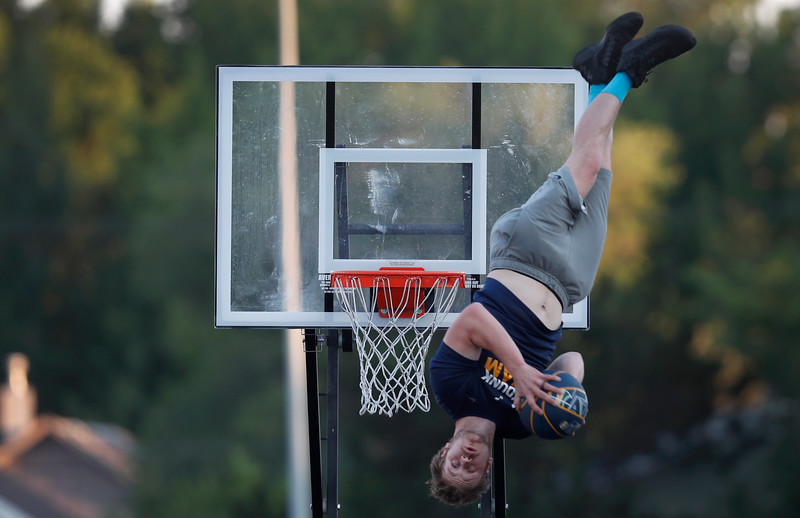 Mike Anderson of the Utah Jazz Dunk Team performs during the 33rd Annual Opening Ceremonies for the Big Sky State Games at Billings Senior High School in Billings, Mont. on Friday, July 20, 2018.