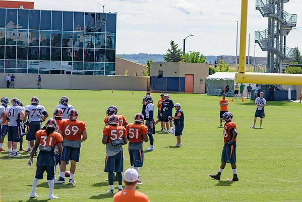 Manning Looks On