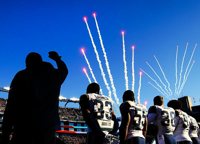 Robert Quinn #94 of the Los Angeles Rams raises his fist during the national anthem before the game against the New England Patriots at Gillette Stadium on December 4, 2016 in Foxboro, Massachusetts.
