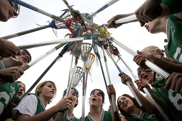 Chris Ammann/Baltimore Examiner The Carver Center for Arts & Technology lacrosse team huddles for a team cheer before taking the field for the second half against Owings Mills High School on Monday, May 8, 2006.