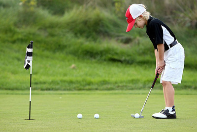 Brandon Wilson, 6, of Perry Hall, practices on the putting green at Mountain Branch Golf Course in Joppa on Wednesday, Oct. 17, 2007. Chris Ammann/Examiner