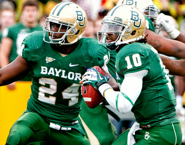 #24 Terrance Gannaway protects #10 RG3 pocket during the 2011 Baylor/UT game.
